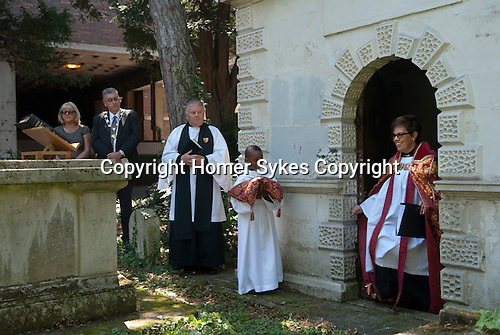 The Inspection of the Gibson Tomb, St Nicholas&rsquo; Church  Sutton Surrey 2016. The Revd Justine Middlemiss Team Rector of Sutton having inspected the tomb.<br /> <br /> Mary Gibson died 10 October 1793 aged 64. In her last Will she bequest to the Minister and Churchwardens &pound;500-00 at 3% consolidated Bank Annuities on trust to be applied amongst other ways as follows. &pound;5-00 to the Minister forever for preaching a sermon on the 12 August.  &pound;5-00 to be distributed that day by the Churchwardens to the poor. &pound;4-00 to be divided between the Churchwardens on that day in every year for surveying and examining the Gibsons family vault.  <br /> <br /> The bequest has now been amalgamated with other bequests  left to the church, the revenues being used in the community.