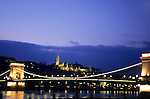 Budapest, Hungary; Chain Bridge (Szechenyi lanc-hid), architect William Tierney Clark, built by Adam Clark, at night.