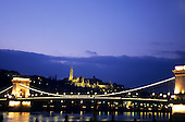 Budapest, Hungary; Chain Bridge (Szechenyi lanc-hid), architect William Tierney Clark, built by Adam Clark, at night.