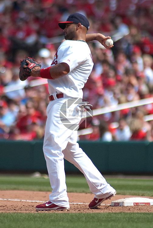 April 3,  2011                           St. Louis Cardinals first baseman Albert Pujols (5) throws to teammate after tagging out at first base. The St. Louis Cardinals defeated the San Diego Padres 2-0 in the final game of a three-game series on Sunday April 3, 2011 at Busch Stadium in downtown St. Louis.