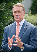 United States Senator David Perdue (Republican of Georgia) speaks to reporters outside the White House after meeting US President Donald J. Trump to discuss his proposed legislation to enact a skills-based immigration system called the Reforming American Immigration for a Strong Economy (RAISE) Act that they claim would also result in a lower level of immigration.<br /> Credit: Ron Sachs / CNP