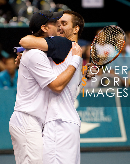 BANGKOK, THAILAND - OCTOBER 03:  Viktor Troicki of Serbia and Christopher Kas of Germany celebrate victory on their doubles match against Jonathan Erlich of Israel and Jurgen Melzer of Austria during the Day 9 of the PTT Thailand Open at Impact Arena on October 3, 2010 in Bangkok, Thailand.  Photo by Victor Fraile / The Power of Sport Images