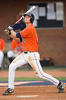 Jarrett Parker #3 of the Virginia Cavaliers follows through on his swing against the St. John's Red Storm at the Charlottesville Regional of the 2010 College World Series at Davenport Field on June 6, 2010, in Charlottesville, Virginia.  The Red Storm defeated the Cavaliers 6-5.   Photo by Brian Westerholt / Four Seam Images