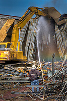 A worker sprays water to keep down the dust as crews demolish the AMC Theatre at the rear of what was once the Westerville Mall at the corner of State Street and Huber Village Boulevard. Now known as the Westerville Plaza, the shopping center was once one of the smaller malls in the suburban Columbus area. In addition to the multi-screen theater, the mall also held clothing stores, a Little Professor book store and was anchored at one end by a Gold Circle store.