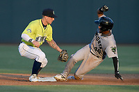 Right fielder Mikey Edie (46) of the Augusta GreenJackets steals second just ahead of the tag of second baseman Chandler Avant (5) of the Columbia Fireflies in a game on Friday, May 31, 2019, at Segra Park in Columbia, South Carolina. Augusta won, 8-6. (Tom Priddy/Four Seam Images)