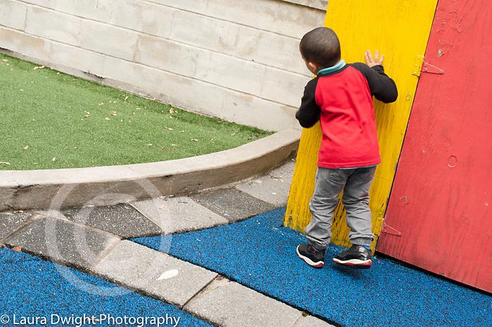 Education preschool outside playground game of hide and seek