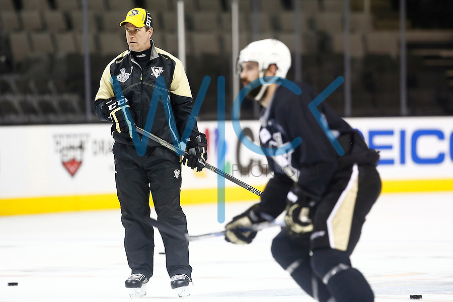 Head coach Mike Sullivan of the Pittsburgh Penguins looks on during practice at the SAP Center in San Jose, California on June 5, 2016. (Photo by Jared Wickerham / DKPS)