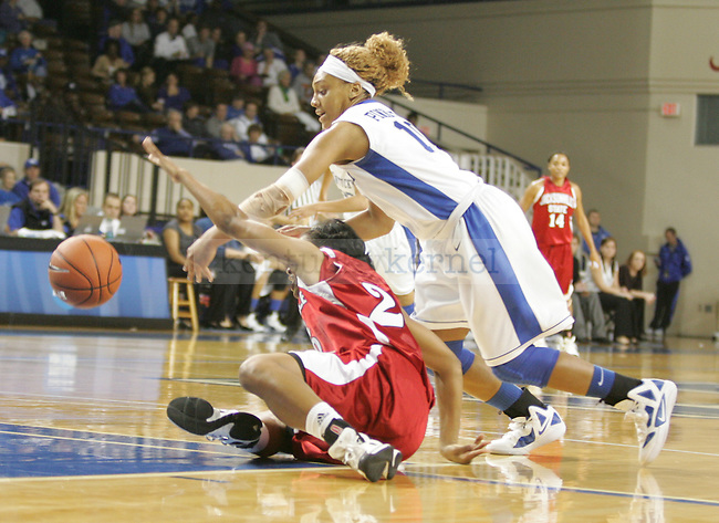 UK guard Bernisha Pnikett scrambles for the ball during the first half of UK's Women's basketball game against Jacksonville State in Lexington, Ky. on 11/15/11. Photo by Quianna Lige | Staff