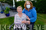 Mairéad Fernane at home, with her daughter Francine Walsh after cutting her hair for a fundraiser for the Kerry Hospice.