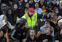 A fan is asked to leave by security during the Super Rugby quarterfinal match between the Hurricanes and Chiefs at Westpac Stadium in Wellington, New Zealand on Friday, 20 July 2018. Photo: Dave Lintott / lintottphoto.co.nz