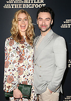 "HOLLYWOOD, CA - FEBRUARY 4: Caitlin Fitzgerald, Aidan Turner, at RLJE Films' ""The Man Who Killed Hitler And Then Bigfoot"" Premiere at the ArcLight Hollywood in Hollywood, California on February 4, 2019. <br /> CAP/MPIFS<br /> ©MPIFS/Capital Pictures"