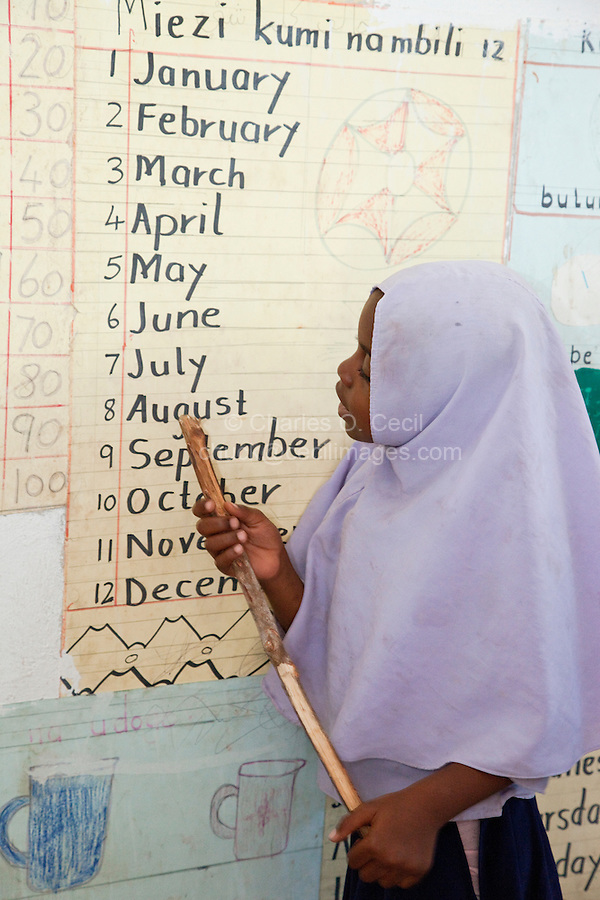 Jambiani, Zanzibar, Tanzania.  School Girl Recites Names of the Months in English.