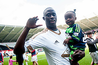 Modou Barrow of Swansea City  on the pitch with team players and staff during a lap of honour after the Barclays Premier League match between Swansea City and Manchester City played at the Liberty Stadium, Swansea on the 15th of May  2016