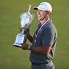 Brooks Koepka holds the U.S. Open Championship Trophy as he poses for pictures after winning the tournament hosted by Shinnecock Hills Golf Club in Southampton, NY on Sunday, June 17, 2018.