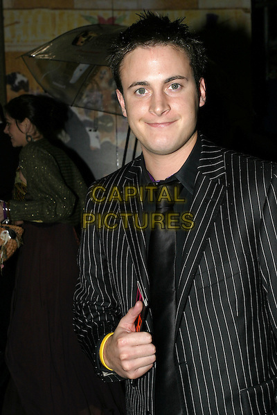 GARY LUCY.At the After Party for the Pioneer British Academy Television Awards (TV BAFTA's), Grosvenor House Hotel, .London, April 17th 2005..half length yellow rubber bracelet bangle wrist band charity.Ref: AH.www.capitalpictures.com.sales@capitalpictures.com.©Adam Houghton/Capital Pictures.