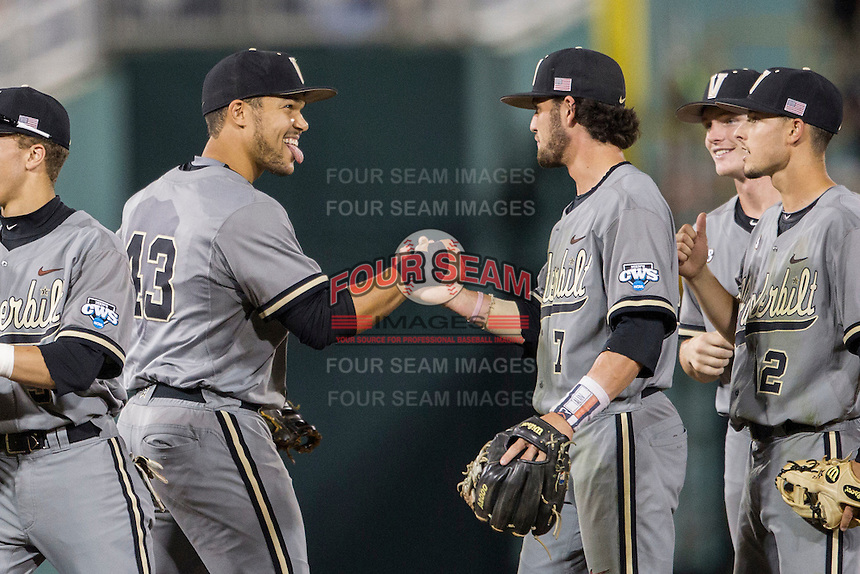Vanderbilt Commodores first baseman Zander Wiel (43) celebrates with shortstop Dansby Swanson (7) after the NCAA College baseball World Series against the TCU Horned Frogs on June 16, 2015 at TD Ameritrade Park in Omaha, Nebraska. Vanderbilt defeated TCU 1-0. (Andrew Woolley/Four Seam Images)