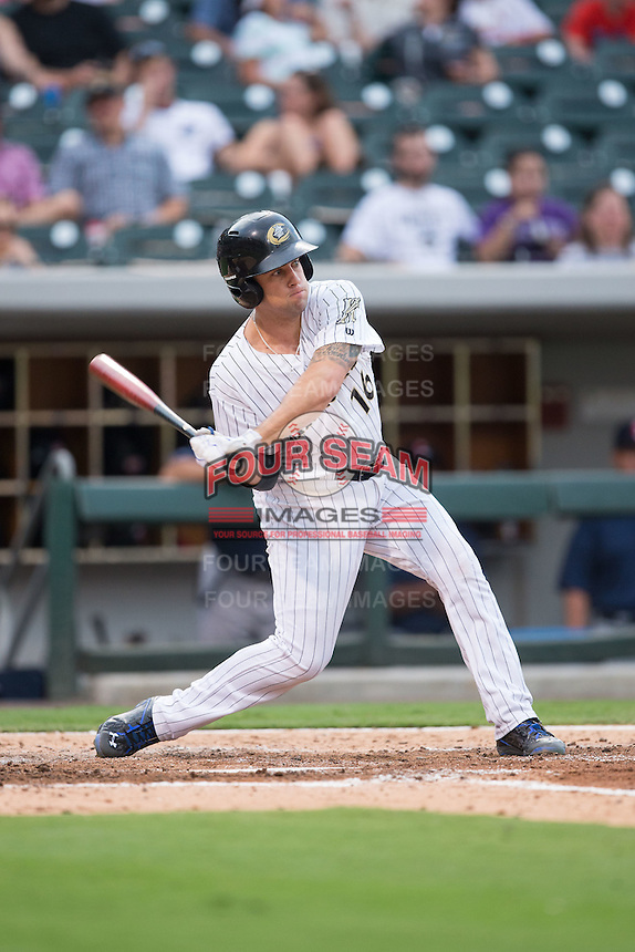 Danny Muno (16) of the Charlotte Knights at bat against the Pawtucket Red Sox at BB&T BallPark on July 6, 2016 in Charlotte, North Carolina.  The Knights defeated the Red Sox 8-6.  (Brian Westerholt/Four Seam Images)