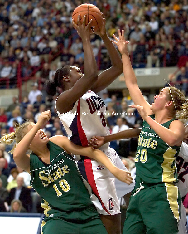 STORRS, CT--21 DECEMBER 2006--122106JS08-UConn's Tina Charles pulls down a rebound between Colorado State's Raysha Ritter, left and Molly Nohr during their game Thursday at Gampel Pavilion in Storrs. <br /> Jim Shannon / Republican-American