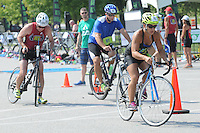 NWA Democrat-Gazette/FLIP PUTTHOFF<br /> SWIM BIKE RUN<br /> Athletes head out on their bikes for a 4. 7-mile ride during the TriFest for MS triathlon held Saturday at the Melvin Ford Aquatic Center in Bentonville. Two triathlons were held Saturday including a super sprint race that involved a 200-meter swim, the 4.7-mile bike leg and 1-mile run. Triathlon events continue today to raise funds for multiple sclorosis research. TriFest for MS benefits the area Rampy MS Research Foundation, said triathlon volunteer Heather Foitek (cq).