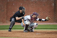 North Carolina Central Eagles catcher Conrad Kovalcik (17) frames a pitch as home plate umpire Lindy Hall looks on during the game against the High Point Panthers at Williard Stadium on February 28, 2017 in High Point, North Carolina. The Eagles defeated the Panthers 11-5. (Brian Westerholt/Four Seam Images)