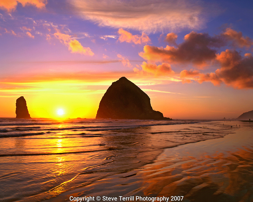 Haystack Rock silhouetted at sunset at Cannon Beach, Oregon