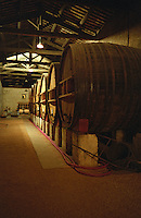 Old wooden fermentation vats (foudres) in the winery at Domaine Saint Martin de la Garrigue, Montagnac, Coteaux du Languedoc, Languedoc-Roussillon, France Grain grainy.