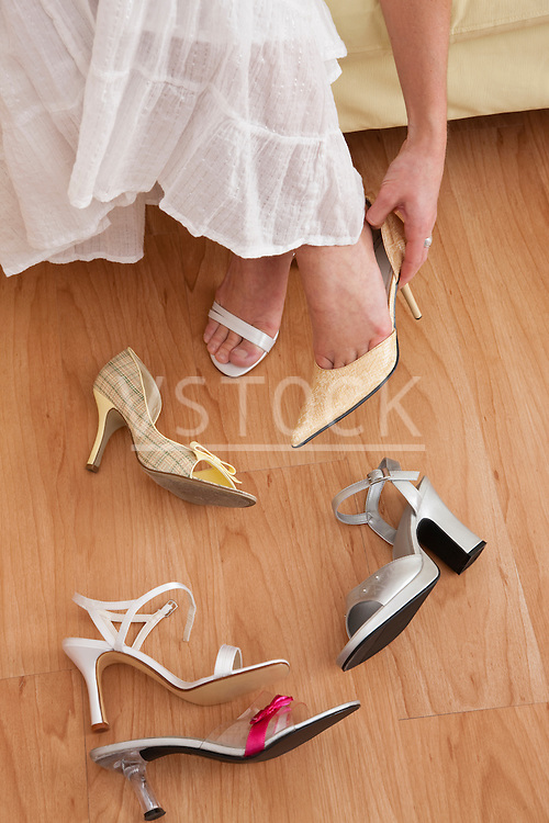 USA, Illinois, Metamora, Woman trying on shoes in store, low section