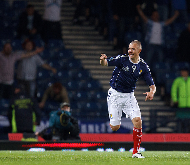 Kenny Miller celebrates after firing in Scotland's equaliser