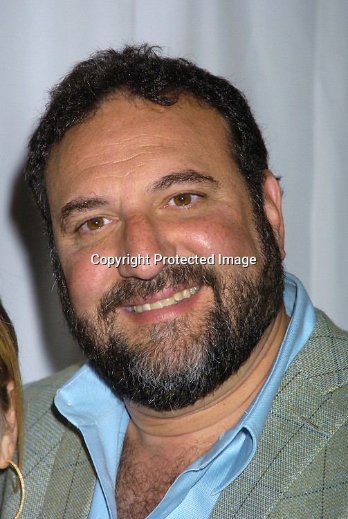 """Joel Silver ..at Madame Tussauds to reveal Paris Hilton's Wax Figure with the Cast of """"House of Wax"""" on May 2, 2005 . ..Photo by Robin Platzer, Twin Images"""