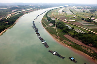 Fish farming on Yongjiang River, next to agricultural fields. /Felix Features