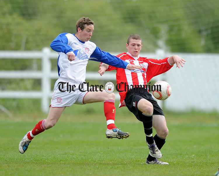 Newmarket's Daithi O' Connell jumps in with a tackle on Darren Murphy. Photograph bY Declan Monaghan