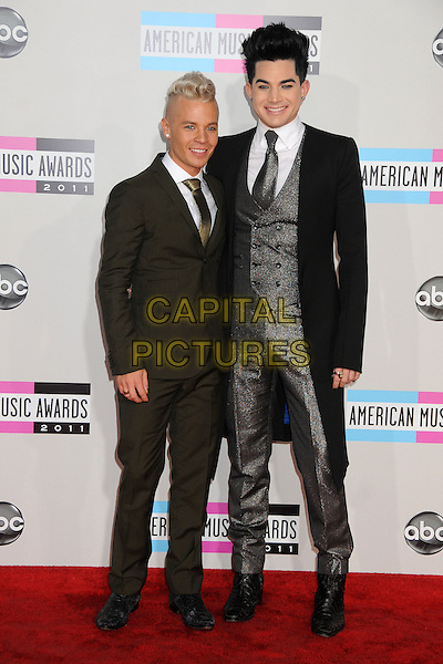Sauli Koskinen & Adam Lambert.2011 American Music Awards - Arrivals held at Nokia Theatre LA Live, Los Angeles, California, USA..November 20th, 2011.ama amas ama's full length grey gray suit black coat silver couple .CAP/ADM/BP.©Byron Purvis/AdMedia/Capital Pictures.