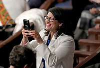 United States Representative Rashida Tlaib (Democrat of Michigan) takes a photo prior to US President Donald J. Trump delivering his second annual State of the Union Address to a joint session of the US Congress in the US Capitol in Washington, DC on Tuesday, February 5, 2019.<br /> CAP/MPI/RS<br /> &copy;RS/MPI/Capital Pictures