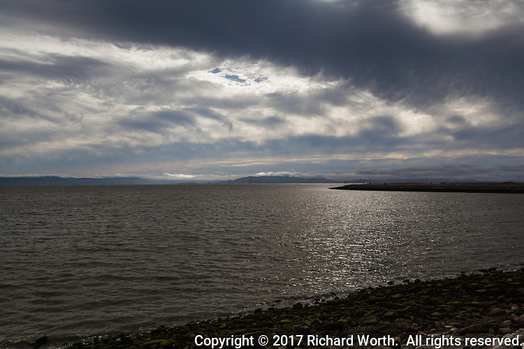 An incoming front fills the sky with an array of clouds over San Francisco Bay.