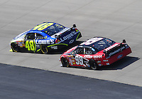 Sept. 21, 2008; Dover, DE, USA; Nascar Sprint Cup Series driver Jimmie Johnson (48) leads Carl Edwards (99) during the Camping World RV 400 at Dover International Speedway. Mandatory Credit: Mark J. Rebilas-