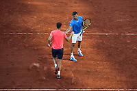 Ryan Harrison shakes hand with Michael Venus during the day 14 of the French Open at Roland Garros on June 10, 2017 in Paris, France. (Photo by Anthony Dibon/Icon Sport)