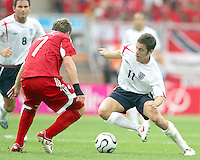 Joe Cole of England puts a move on Chris Birchall of Trinidad. England defeated Trinidad & Tobago 2-0 in their FIFA World Cup group B match at Franken-Stadion, Nuremberg, Germany, June 15 2006.