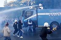 "Roma: scontri tra manifestanti violenti e polizia durante la manifestazione organizzata dagli indignati. ""Occupy Wall Street"" è stata organizzata in 951 città di 82 Paesi per protestare contro la crisi economica mondiale...Rome: Demonstrators throw attack a police truck  during the demonstration against the economical crisis inspired by the ""Occupy Wall Street"" and 'Indignant' movements."