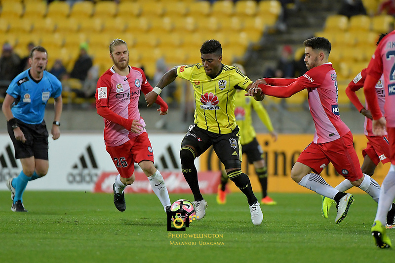 Wellington Phoenix&rsquo;  Rolieny Bonevacia and Melbourne City FC's Anthony Caceres in action during the A League - Wellington Phoenix v Melbourne City FC at Westpac Stadium, Wellington, New Zealand on Saturday 8 October 2016.<br /> Photo by Masanori Udagawa. <br /> www.photowellington.photoshelter.com.