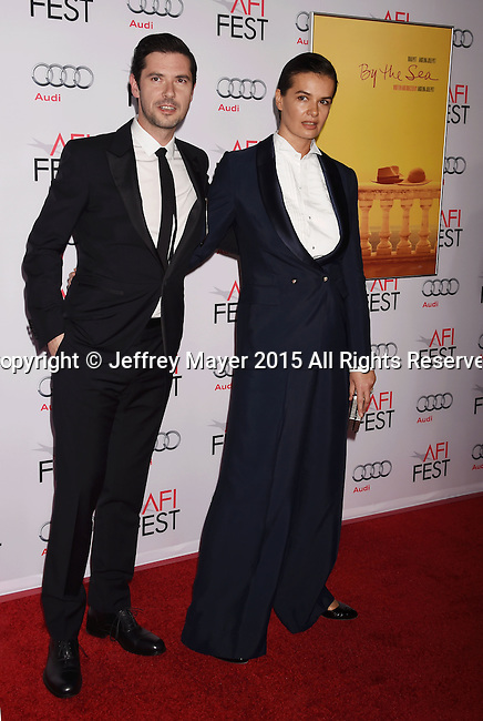 HOLLYWOOD, CA - NOVEMBER 05: Actor Melvil Poupaud (L) and guest arrive at the AFI FEST 2015 presented by Audi Opening Night Gala Premiere of Universal Pictures' 'By The Sea' at TCL Chinese 6 Theatres on November 5, 2015 in Hollywood, California.