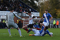 Alex Jones of Grimsby Town is denied by Wes Atkinson of Eastleigh during the Vanarama National League match between Eastleigh and Grimsby Town at The Silverlake Stadium, Eastleigh, Hampshire on Nov 21, 2015. (Photo: Paul Paxford)