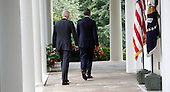United States President Barack Obama, with U.S. Vice President Joseph Biden at his side, makes a statement on immigration reform in the Rose Garden of the White House in Washington, D.C. on June 30, 2014<br /> Credit: Dennis Brack / Pool via CNP
