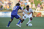 23 April 2009:  Danleigh Borman (right) of the Red Bulls tries to move the ball around Santiago Hirsig (10) of the Wizards.  The MLS Kansas City Wizards defeated the visiting New York Red Bulls 1-0 at Community America Ballpark in Kansas City, Kansas.