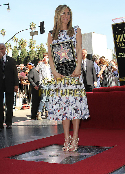 Jennifer Aniston.Jennifer Aniston is honored with a Star on the Hollywood Walk of Fame on Hollywood Blvd., Hollywood, California, USA..February 22nd, 2012.full length white blue print dress plaque .CAP/ADM/KB.©Kevan Brooks/AdMedia/Capital Pictures.