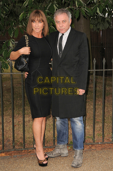 MEG MATTHEWS & PETER SIDELL.The Summer Party at The Serpentine Gallery, London, England. .July 9th, 2009 .full length black dress grey gray coat bag purse married husband wife leopard print shoes peep toe .CAP/CAS.©Bob Cass/Capital Pictures.
