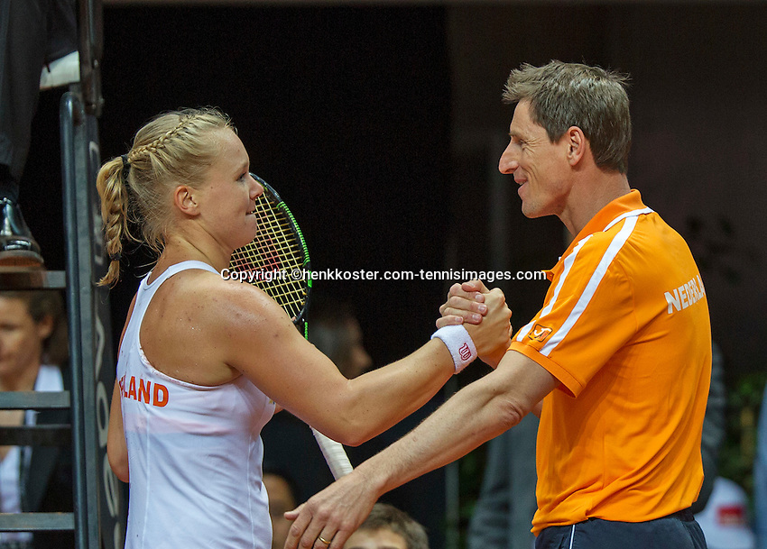 Arena Loire,  Trélazé,  France, 16 April, 2016, Semifinal FedCup, France-Netherlands, First match: Kiki Bertens vs Caroline Garcia, Kiki Bertens (NED), Photo: Kiki Bertens is congratulated by captain Paul Haarhuis after making the first point for the Netherlands, 1-0<br /> <br /> Photo: Henk Koster/Tennisimages