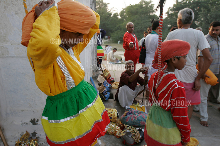 .RAMNAGAR, UTTAR PRADESH, INDIA - OCTOBER 5, 2005 : Actors prepare before the start of the 19th day-episode of the Ramlila in Ramnagar on October 5, 2005. The Ramlila is the play of the Hindu scripture 'the Ramayana' which depict the struggle of the god Ram and his fight against the Demon God Ravana. The Ramlila of Ramnagar has been organized by the Maharaja of Benares since the early 1800s and is still its most authentic rendition, a reference to other Ramlilas. It last for 31 days and is staged over a 10 square mile area and It is the largest theater production in the world .(Photo by Jean-Marc Giboux)