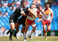PICTURE BY VAUGHN RIDLEY/SWPIX.COM - Rugby League - Super League Magic Weekend - Catalans Dragons v London Broncos - Eithad Stadium, Manchester, England - 27/05/12 - Catalans Ben Fisher is tackled by Londons Tony Clubb and Shane Rodney.