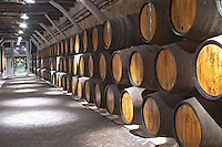 barrels with aging port sandeman port lodge vila nova de gaia porto portugal