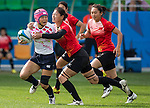 China plays Japan during the17th Asian Games 2014 Rugby Womens Sevens tournament on October 01, 2014 at the Namdong Asiad Rugby Field in Incheon, South Korea. Photo by Alan Siu / Power Sport Images